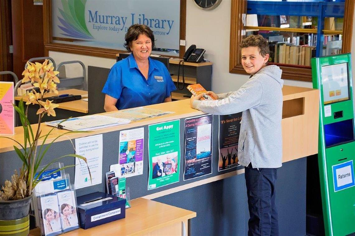 Murray Library Customer Service Officer Assisting Customer